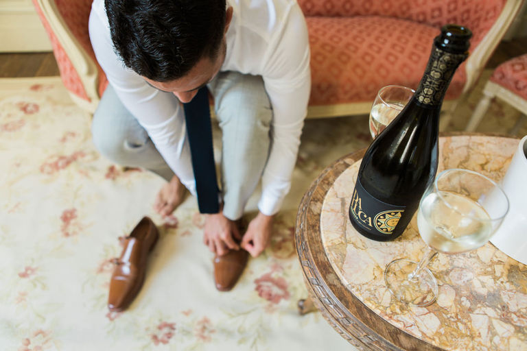 Grooms Shoes and Champagne before the Wedding at Chateau la Durantie in France