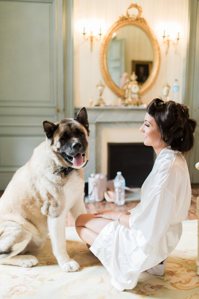 Bride and her Dog at the Wedding at Chateau la Durantie in France